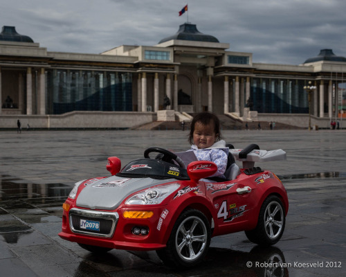 The UlaanBaatar Parliament Building Sükhbaatar Square plus a little girl and her car, which was being driven by her father with a remote control unit. I will be heading away from internet for the next week or so.