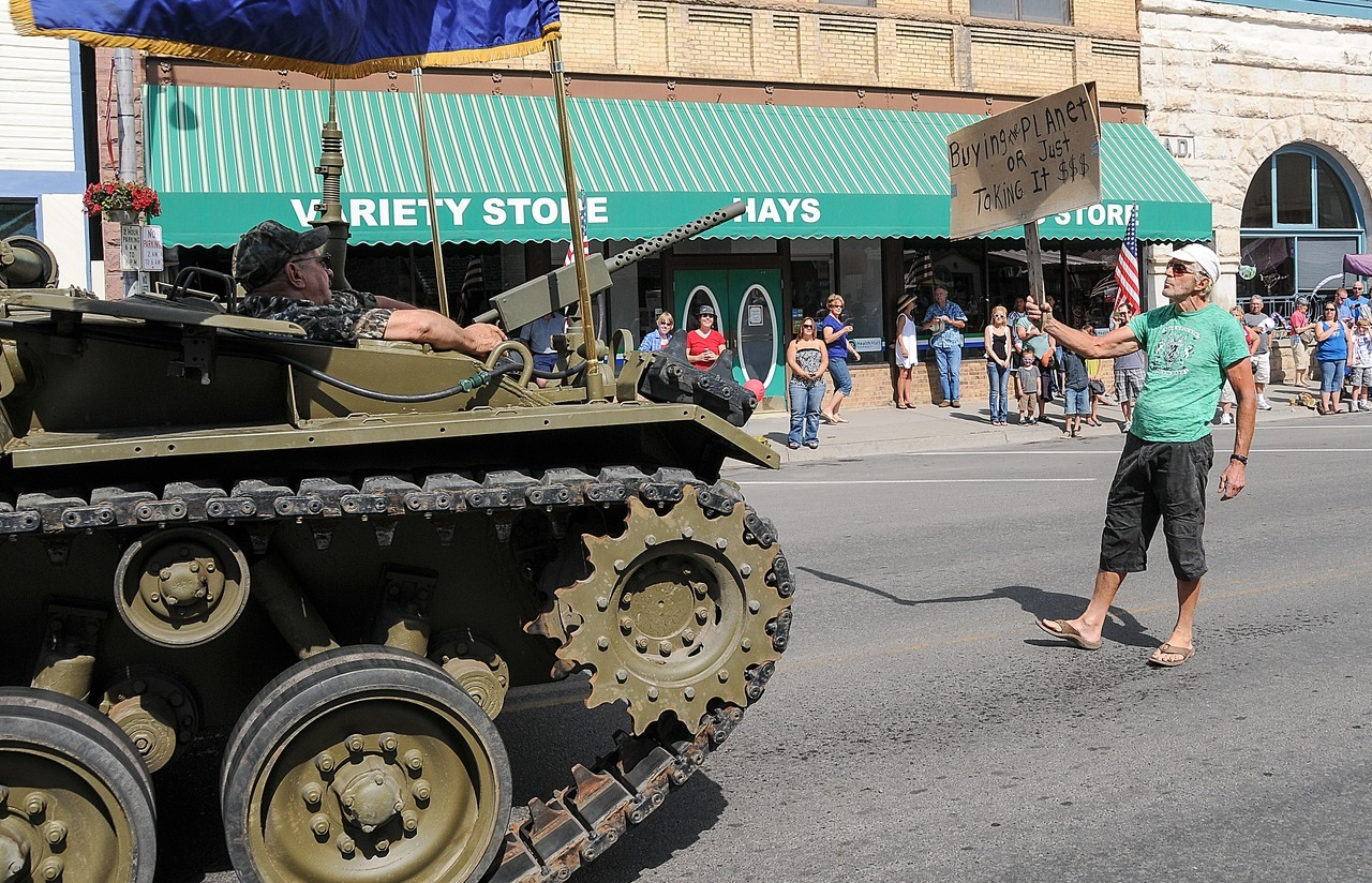 'Tiananmen Sid' faces down tank in Paonia's Fourth of July parade A standoff between a sign-wielding hairdresser in flip-flops and an anti-aircraft tank during Paonia's annual Cherry Days Parade, held each Fourth of July, has generated social-media buzz about comparisons to China's Tiananmen Square protests and the iconic image of a lone protestor standing in front of a line of tanks. Read the full story here. (Photo courtesy of Jim Brett)