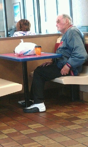 Old head. 92 years old. Seen here in Jordan 12s, Dickies, and a Brooklyn baseball jacket. Stopped into McDonald's for coffee before completing his 5th of July walk of shame. Snuck a few bites from a mac n' cheese plate concealed in white bag.  reader submitted