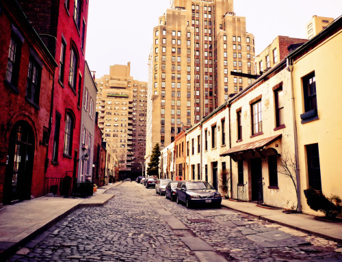"Washington Mews on a cloudy day. Greenwich Village, New York City.  There are streets that I revisit with regularity. These streets seem to call me back again and again. Tucked away and nearly hidden, they are treasure chests that open to reveal a wealth of warm, new feelings with every passing season. I used to come to this particular street quite a bit but it wasn't until a year or so ago that I learned about its history.  The street sits on land that in the 18th century was part of a large farm that contained private stables used by the families of men such as nineteenth century architect Richard Morris Hunt, John Taylor Johnston who was the founding president of the Metropolitan Museum of Art , and Pierre Lorillard who was a prominent American tobacco manufacturer.  In the first half of the 20th century, a community of about 200 painters and sculptors flourished on this particular street and another adjoining street in the area. In 1903, a reporter for the New York Tribune wrote: ""One finds a strange mixture of bales of hay and enormous blocks of marble, boxes of plaster and barrels of oats littering the roadways. Truckmen in greasy jumpers touch elbows now and then with the sculptors in their clay spattered working garb.""  One of the more prominent artists who had a studio on this beautiful street was Edward Hopper. Edward Hopper lived close to Washington Mews at 3 Washington Square starting in December 1913 until his death in 1967.  —-  View this photo larger and on black on my Google Plus page  —-  Buy ""Washington Mews - Greenwich Village - New York City"" Prints here, email me, or ask for help."