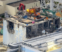 Rubble was removed on Thursday from the damaged building for Reactor No. 4 at the Fukushima Daiichi Nuclear Power Plant. (Kyodo News, via Associated Press)