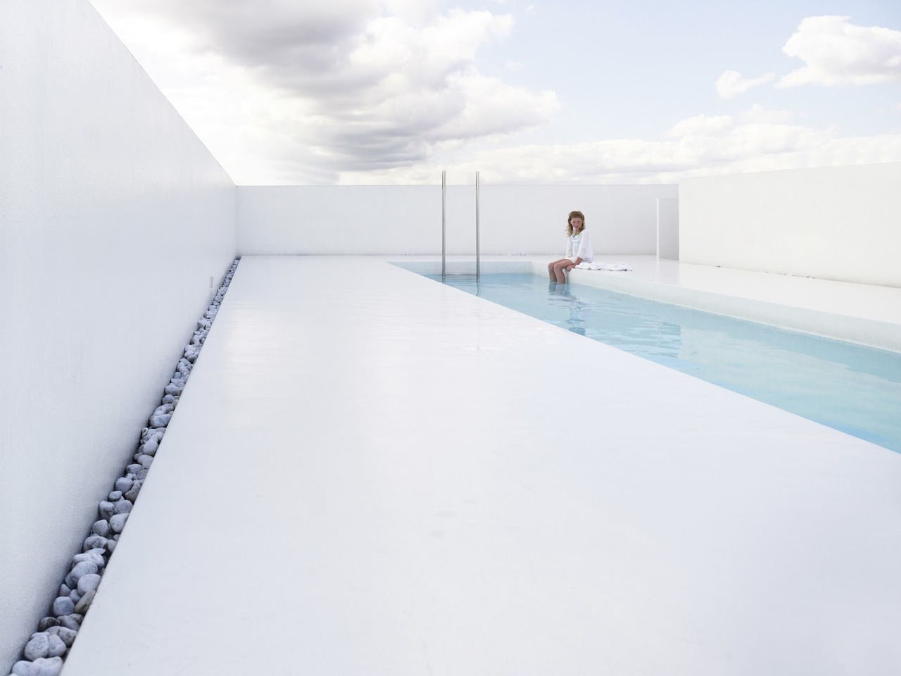 Swimming pool on top of a 17th century old gentleman's house in the center of Grimbergen, Belgium. Designed by dmvA Architecten, photo by Frederik Vercruysse.