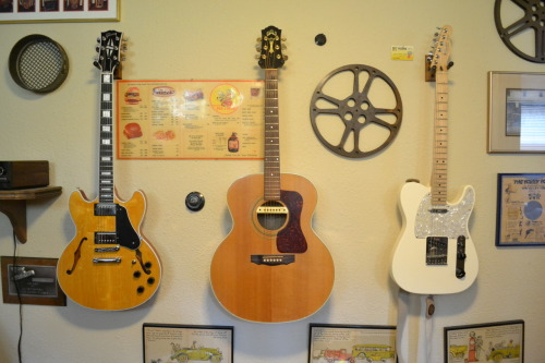 "Gibson Custom 335, Guild Acoustic and a Fender Telecaster. Most families have pictures of their loved ones hanging up on the living room wall, Dustydoughnut sent in this photo of what he's got instead, saying ""These are my dad's favorites from his collection. From the left there's a brand new American Gibson Custom, a beautiful '01 American Guild acoustic and then the '09 Mexican Telecaster. Enjoy!"""