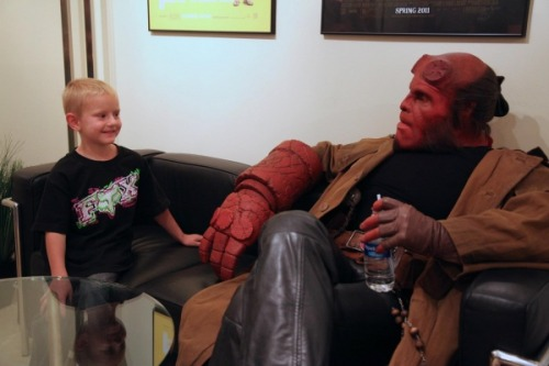 under-your-boot-soles:  murmurandshout:  Ron Perlman Reprises Hellboy Role For The Very Best Reason Possible   The Make-A-Wish Foundation contacted FX house Spectral Motion with a unique request from a little boy: he wanted to meet Hellboy. And maybe become him as well. And so young Zachary came to the Spectral Motion offices where he found Hellboy himself - Ron Perlman had returned to wear the make-up and outfit, and he had a big burgers, fries and shakes lunch with Zachary.  Give me second, there's something in my eye.  I'm so happy.