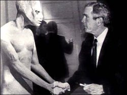 pin-upscripture:  President Bush and the reptilian Ambassador.