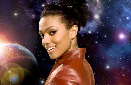 'Doctor Who' Cosplay: How To Dress Like Martha Jones  Here's how to get the basic Martha, though: 1: Hair – Black and up. Very businesslike. Smart and out of the way, apart from the odd rogue strand deliberately hung across the face. 2: Jacket – zip-up burgundy leather windcheater, waist length. It's a different color to the Rose Tyler jacket, but if you're stuck, you could probably swap the one for the other. Martha and Rose are so physically different no one could really confuse the two. 3: Top – one of those vest-tops with lacy trimmings at the top, of a similar color to the jacket but a bit lighter, and a bit longer. 4: Jeans – boot cut, blue-black, stonewashed and long. 5: Shoes – as you can see, Martha likes her power heels. Something black and booty would be ideal. 6:Accessories – small golden hoop earrings and a subtle gold necklace. Couple of rings on her left hand.  Get the details at Anglophenia | BBC America)
