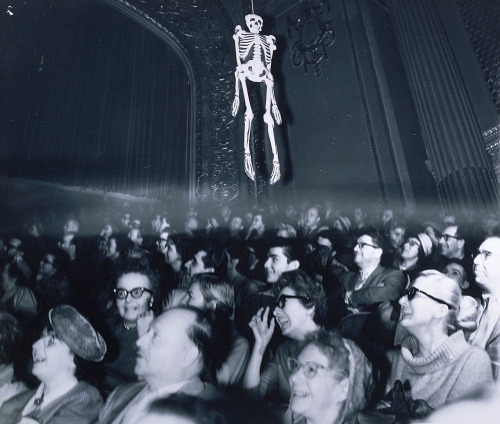 Weegee (Arthur Fellig), Untitled (In the Movie House Watching House on Haunted Hill), 1959.