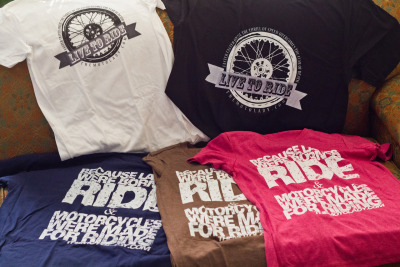 Awww yeah! The tshirt schwag pile has arrived. Like what you see? Head on over to the MotoLady Schwag Shoppe and GET SOME! :)