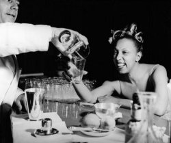 vintageblackglamour:  Josephine Baker relaxes with a cocktail in Venice after a hard day's work in 1940. Photo: Getty Images.