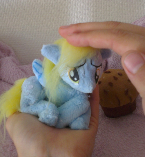 bunnyharerabbit:  My little pony plush FiM - Mini beanie Derpy & muffin on eBay from epic_rainbow_crafts  Hello everyone!   This sad little mini derpy needs a new home, as she keeps stealing my muffins …. she will be given a muffin as travel food on the way to her new owner! does anyone have a home for this little derpy?   This is a mini plushie, she is 7.5 inches long (laying down) from front hoof to back hoof. she comes with her own plushie muffin =) She is a beanie plushie and can be posed as you wish. (stuffed with fiber filling in her head, aswell as some in her neck for extra softness and stability)    If you have any questions, feel free to contact me. I ship worldwide , shipping is around 12$ worldwide and about 8$ within europe (trackable package). Other shipping methods can be made if asked specifically. Lots of picturesbelow! Happy biding =)