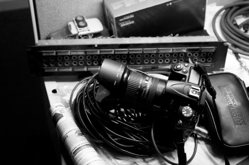 The Sound Guy's Toys and Tools in B&W: Surge II. UC Davis, 06-29-12. My friend Jessie's camera and model Mimi in his cubicle.