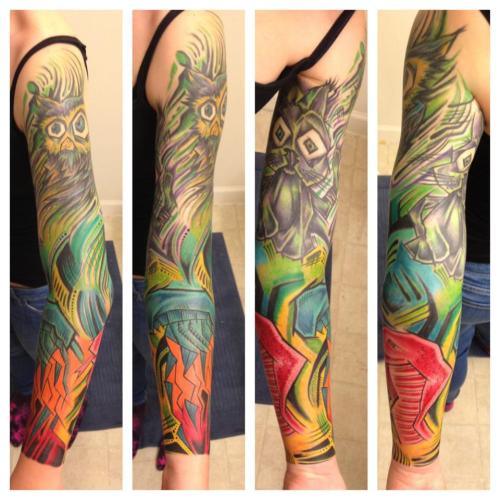 My abstract cubism-style sleeve was finally finished in late April of this year. Dietsch, who is currently at Bombs Away Tattoo in Eastern North Carolina, USA did it in three sessions, which added up to a total of about 15 hours. I told Dietsch that I wanted to combine my favorite animals, owls, cats, jellyfish, and snakes and this is the end result. The owl has been submitted to FYT before here. I'm absolutely so stoked with this came out, Dietsch really brought it to life and I get so many compliments on it daily! The photo was taken right after the bottom half from the elbow/ditch down was done.