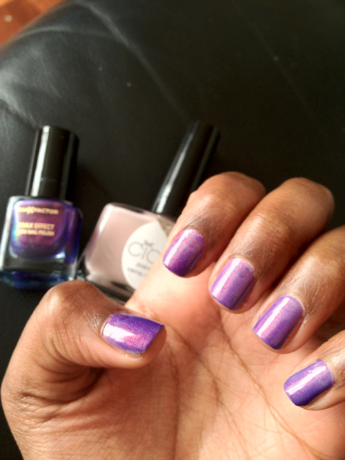 a translucent purple over a nude nail polish creates nail perfection