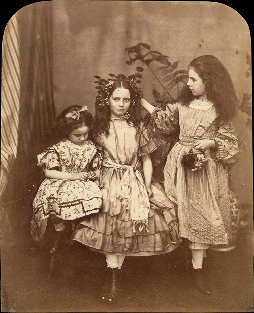 "solo-vintage:  Lewis Carroll, 1863 Irene and Mary MacDonald were two of the five children of Scottish novelist and poet George MacDonald. Carroll was a friend of the family, and the children affectionately called him ""Uncle."" It was the MacDonalds to whom he read the manuscript of The Adventures of Alice and who urged him to publish the work. Carroll photographed the family on several occasions. This photograph, which includes the children's friend Flo Rankin standing in the middle, was produced during the photographer's stay at Elm Lodge in Hampstead the week of July 25, 1863. via"