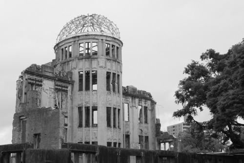 At 8:15 on August 6, 1945, the world's first atomic bomb used in war just missed its intended target, the Aioi Bridge, and detonated about 150m from Hiroshima's exhibition hall, now known as the Genbaku Dome / The A-bomb Dome. Because the bomb detonated almost directly above the hall, the buildings vertical columns were able to withstand most of the downward force, and some of the building was able to remain intact, unlike most of the buildings in the area. Everyone in the building died immediately. An estimated 70,000 people in the city died instantly, and another 70,000 died by 1950 due to injuries and radiation. Hiroshima was rebuilt around the dome, and in 1966 (after much debate) it was decided to preserve the building. In 1996 it was declared part of UNESCO's World Heritage list.