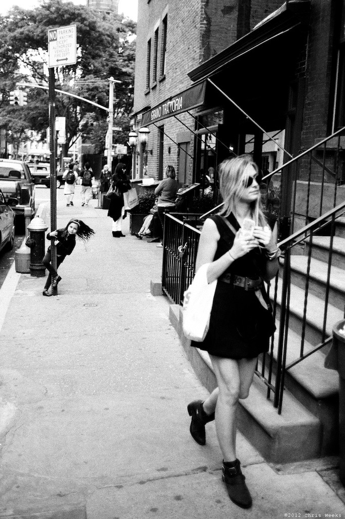 NYC, New York:  May, 2012.  Little girl.  Big girl.   Leica MP.  35 'lux.  Lab scan »> Aperture.  (Fuji Neopan 400 with ND)