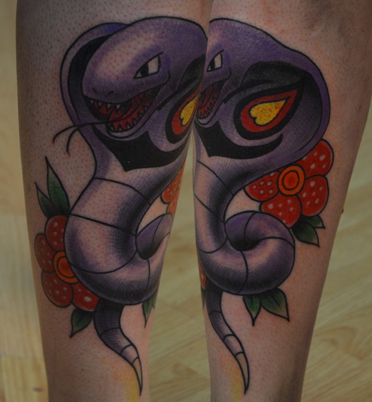fuckyeahtattoos:  Free-hand traditional styled Arbok with Vileplume flowers on Fern from Before Their Eyes.http://johnembrytattoos.tumblr.com  http://www.facebook.com/pages/Studio-14-Tattoos-and-Body-Piercings/131300733088