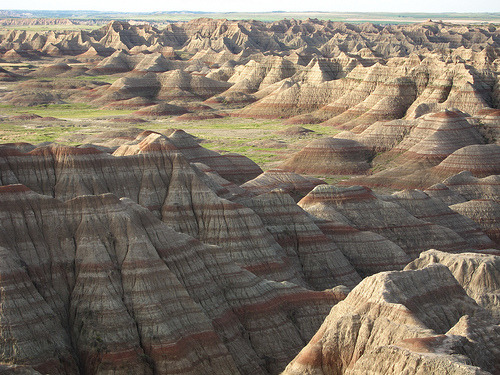crownedrose:  Strata is a term we use in geology and stratigraphy, which is the rock layers/bands clearly defined like in the photo above. The word stratum is for one layer, whereas strata is for multiple layers. The photo above is by calwest on Flickr, which is a photograph of the Badlands in South Dakota.