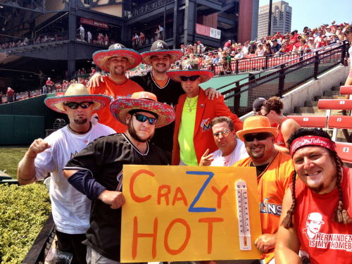 Marlins fans brave the 106-degree heat in St. Louis with sombreros.