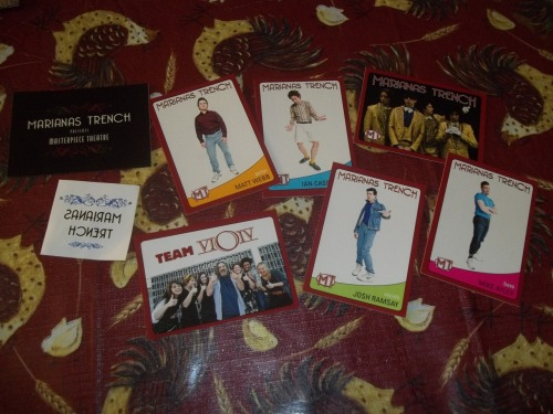 """flytothestarswithmebaby:  hey guys, so i used to be a huge Marianas Trench fan, but i've just became less obsessed i guess haha, anyway i have some """"old"""" merch that is just taking up space in my bedroom so i decided to do a giveaway, i know when i was a huge fan i would of died from excitment seeing this so i wanted to give you guys the chance to """"fangirl"""" ;) the giveaway will end SEPTEMBER 15th!!!! im not a mt blog, but most of the things i reblog won't clutter your dashboard anyway.. WHAT IT INCLUDES: -MT trading cards with facts on back-MT masterpiece theatre sticker-MT tattoo-MT masterpiecetheatredirectors cut-Fix Me poster, it has a few tears on the edges because its fallen off my walls, but if u dont want it, throw it out.-3MT buttons-19 photos of the boys, mostly josh that i got printed out at walmart. its not shown in the picture, but i also ordered there first album for the giveaway -Fix Me RULES: Must be following me, and her. I'm mostly a hipster blog, and she is a 1d blog, if your not a fan of our blogs and the things we reblog you can unfollow when the contest is over, idrc, we will be checking. Reblog as many times as you want, idc if you like it, but likes won't count,i'm using a randomizer to pic the winner MUST REACH 700 NOTES because i spent my own money on this stuff and i was only 13 and was broke xD also, you have ALL summer to reblog this and get notes on it. i know you guys can do it haha. I will pay for shipping in North America, and i will pay HALF for the UK,if you win and u live in the uk and i have the money on me then i will pay the full. Winner will have 48 hours to respond before i pick someone else to win. ANYTHING ELSE? i don't think im forgetting anything, but if you have any questions ask ME, julie can't answer them, also messaging me will get you an extra chance at winning. have fun, and please no drama or i will disqualify you"""