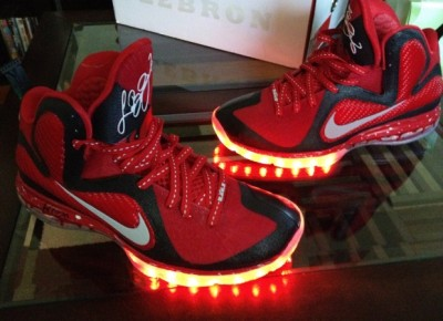 "dobyshoes:  Nike LeBron 9 ""PE Lights"" Custom LeBron's player exclusives get all the way turned up on the Nike LeBron 9 ""PE Lights"" Custom. A red and black pair likens LeBron's on court colorway, while LED soles put the Sole Swap stamp on the King James signature. (via Nike LeBron 9 ""PE Lights"" Custom — NiceKicks.com)"