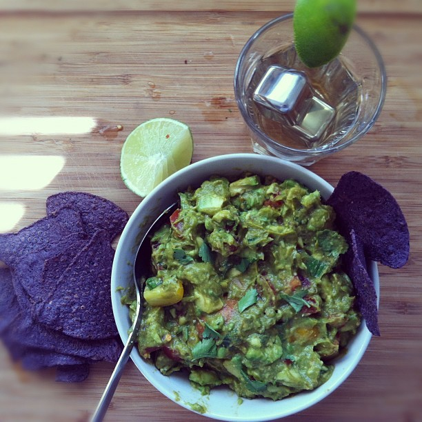 rebeccalando:  At-home happy hour. Guacamole and tequila.