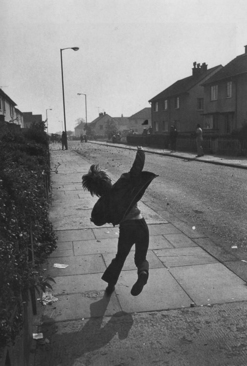 Gilles Peress Boy throwing stones at British soldiers in Northern Ireland, 1971 Thanks to firsttimeuser