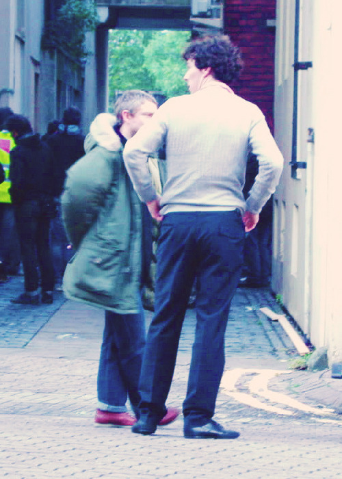 """Damn it, Sherlock. Why did you have to leave the flat in my jumper? Did we really need to give them another reason to speculate?"" John scowls at Sherlock's wool-clad torso. ""It's comfortable, John. And warm."" Something about Sherlock's smug grin makes John laugh. ""Why don't you have your bloody coat, anyway? It's freezing out here."" ""Mm, yes, speaking of coats, why did you keep that abomination of a parka? I hope it wasn't for the memories."" John grumbles, stuffing his hands in his pockets. Sherlock's hit too close to home. The parka doesn't remind him of the vest that was hidden underneath it - it reminds him of the look on Sherlock's face, the look when he realised Sherlock actually cared about him, about his safety, about their lives together. ""Shut up, Sherlock. And you still haven't answered my question. Where the hell is your coat?"" Sherlock mumbles, indistinct. ""Say again?"" ""Back at the flat. It doesn't smell like you."" He stares off into the distance, avoiding eye contact, but John can see the flustered embarrassment on Sherlock's face. ""Oh come here, you ridiculous git."" Grinning, John grabs Sherlock, feeling the alien warmth of his own jumper under his fingers, and uncaring of the watching policemen and roaming reporters, presses his lips firmly to Sherlock's. Now people will definitely talk."