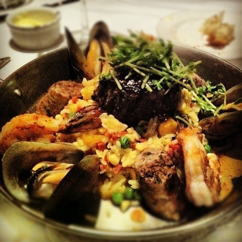 Just remembering this meal I had some weeks ago. Seafood paella! My GOD I love paella and could really go for this right now. Shrimp, sausage, mussels, saffron rice peas, herbs and a small filet mignon in the center. :drool:  (Taken with Instagram)