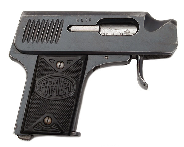 "peashooter85:  Strange Indeed! The .25 Praga Pistol Made in Czechoslovakia, these little pistols were made from 1921 to 1926 with only 7,400 being produced. They have a fold out trigger for ease of carry, but its most curious feature is a small ""thumb groove"" on the slide. This was used to cock the pistol one handed using your thumb."