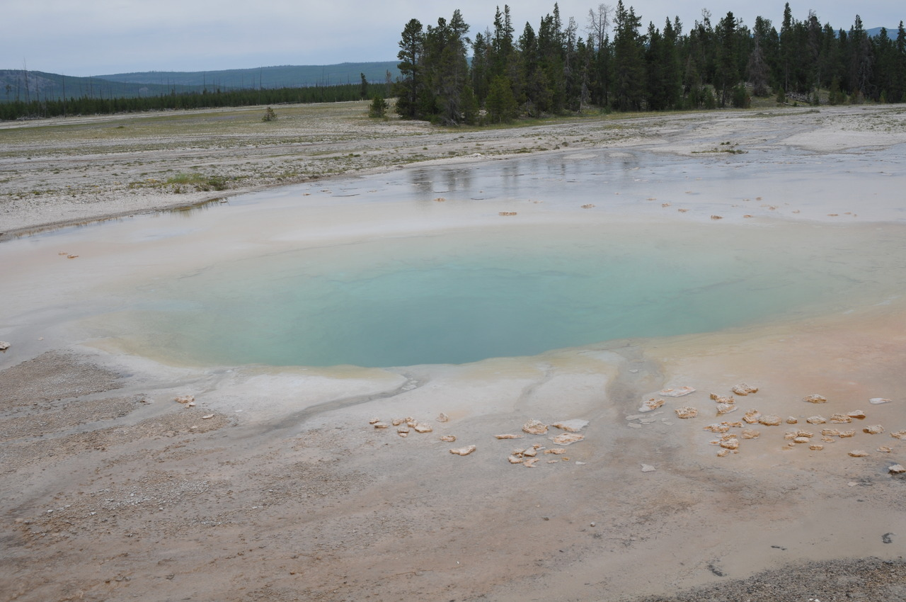 Midway Geyser Basin This was probably by far my favorite. The colors were amazingly brilliant. And the size of the crowds did not disappoint, either. The star attraction by far is Grand Prismatic Geyser, with its myriad colors - it is utterly kaleidoscopic. There is Turquoise Pool (the first one you will encounter), Excelsior Geyser and Opal Pool, which both are brilliantly blue.
