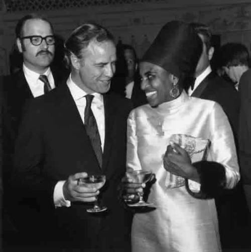 Miriam Makeba and Marlon Brando enjoying champagne on Ms. Makeba's opening night at the Cocoanut Grove in Los Angeles on April 2, 1968. Photo: Max B. Miller/Fotos International/Getty Images.