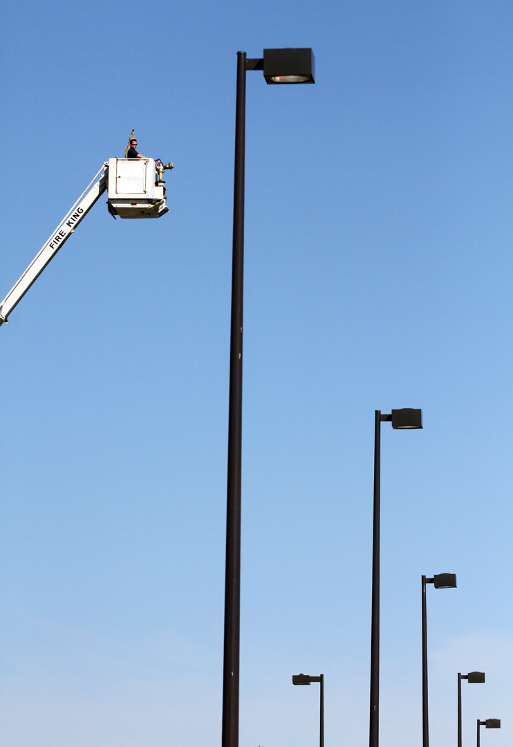 Firefighter Adam Corey looks out from a firefighters' ladder over Home Depot's parking lot on Regent street on Thursday afternoon. Starting from his perch on Thursday morning, ending Saturday, Corey hopes to raise money for Muscular Dystrophy. (Cole Burston/The Daily Gleaner)