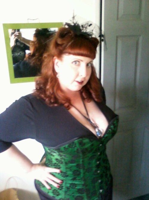 """me in one of my favorite corsets"" Just for the record, for those of you taking notes at home, THIS is the way you wear a corset. Way to take our breath away with this submission, mistere1smissus156!  (Sidenote: Lovin' the hair, HOTT MAMA ALERT.)"