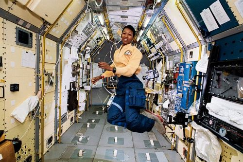 "Mae Carol Jemison (born October 17, 1956) is an American physician and NASA astronaut. She became the first black woman to travel in space when she went into orbit aboard the Space Shuttle Endeavour on September 12, 1992. After her medical education and a brief general practice, Jemison served in the Peace Corps from 1985 to 1987. She resigned from NASA in 1993 to form a company researching the application of technology to daily life. She has appeared on television several times, including as an actor in an episode of Star Trek: The Next Generation. She is a dancer, and holds 9 honorary doctorates in science, engineering, letters, and the humanities. After the flight of Sally Ride in 1983, Jemison felt the astronaut program had opened up, so she applied.[1] Jemison's inspiration for joining NASA was African-American actress Nichelle Nichols, who portrayed Lieutenant Uhura on Star Trek. Because of her love of dance and as a salute to creativity,[1] Jemison took a poster from the Alvin Ailey American Dance Company along with her on the flight.[19] ""Many people do not see a connection between science and dance,"" says Jemison.[8] ""but I consider them both to be expressions of the boundless creativity that people have to share with one another.""[8] Jemison also took several small art objects from West African countries to symbolize that space belongs to all nations.[1] Also on this flight, according to Bessie Coleman biographer Doris L. Rich, Jemison also took into orbit a photo of Coleman—Coleman was the very first Afro-American woman to ever fly an airplane. Jemison resigned from NASA in March 1993.[10] ""I left NASA because I'm very interested in how social sciences interact with technologies,"" says Jemison.[20] ""People always think of technology as something having silicon in it. But a pencil is technology. Any language is technology. Technology is a tool we use to accomplish a particular task and when one talks about appropriate technology in developing countries, appropriate may mean anything from fire to solar electricity."" In an interview with the Des Moines Register on October 16, 2008 Jemison said that she was not driven to be the ""first black woman to go into space."" ""I wouldn't have cared less if 2,000 people had gone up before me … I would still have had my hand up, 'I want to do this.'"" In 1993 Jemison founded her own company, the Jemison Group that researches, markets, and develops science and technology for daily life.[10] In 1993, Jemison also appeared on an episode of Star Trek: The Next Generation.[21] LeVar Burton found out, from a friend that Jemison was a big Star Trek fan and asked her if she'd be interested in being on the show, and she said, ""Yeah!!""[22] The result was an appearance as Lieutenant Palmer in the episode ""Second Chances""."