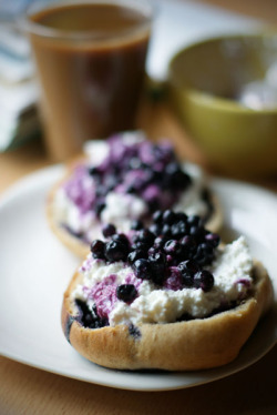 Sweet wholemeal bun with cottage cheese and blueberries, ice coffee with soy milk.