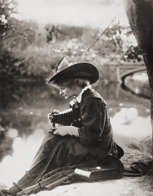 Woman With Kodak Camera c.1900. via Vintage Photography