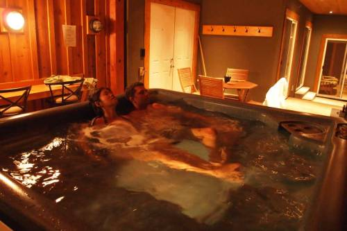 Just had a nice midnight soak in our private hot tub. After long busy day, it felt so good to relax our muscles and minds in the hot tub on our beautiful patio, facing the pine forest and snow capped Columbia Mountains. Cedar House Chalet, Golden BC, Canada ~Team Eagle (Ryan and Dina VagabondQuest.com)