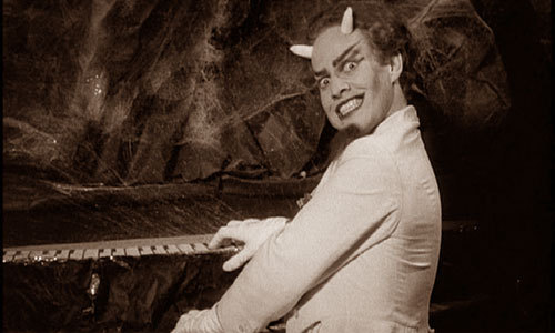 fuckyeahelfmanburtonboingo:  Forbidden Zone (1979) » Satan » Danny Elfman  Recently I realized that when I admire a talented man that I also find attractive, I come up with a lovingly handcrafted insult that instantly comes to mind every time he does. Michael Fassbender?  That terrifying ice-blond entity.  H.P. Lovecraft?  That bigoted long-jawed Yankee son-of-a-bitch.  Danny Elfman?  This evil ginger bastard.  I wanted him on my dash just once more and this entry is an excuse for that.