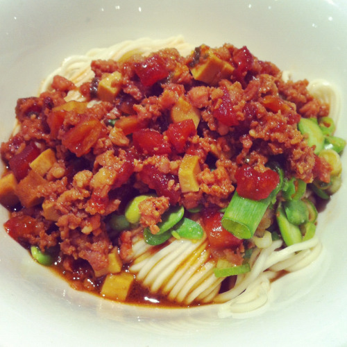 Hongkong food: egg noodle topped with minced pork and chili oil sauce