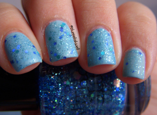 All That Glitters | Heartbeat City layered over China Glaze Seaspray, mattified <3