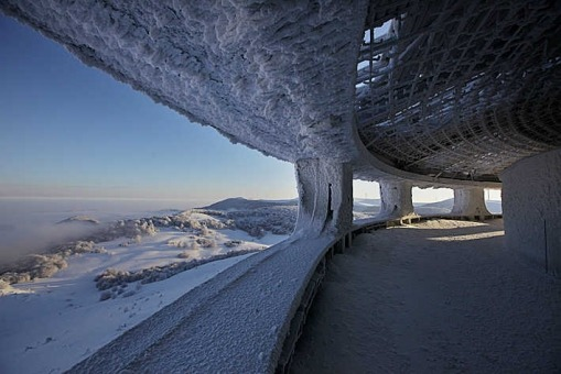 "heterochronia:  Buzludha is Bulgaria's largest ideological monument to Communism. Designed by architect Guéorguy Stoilov, more than 6000 workers were involved in its 7 year construction including 20 leading Bulgarian artists who worked for 18 months on the interior decoration. A small, universally expected donation from every citizen in the country formed a large portion of the funds required to build this impressive structure that was finally unveiled in 1981 on what was the 1300th anniversary of the foundation of the Bulgarian state. Buried in the monument's concrete structure, is a time capsule containing a message for future generations explaining the significance of the building. In September 2011, the Bulgarian cabinet transferred ownership of the monument to the Bulgarian Socialist party. Bulgaria's Prime Minister Boyko Borisov declared, ""We shall let them take care of it because here it also holds true that a party which does not respect its past and its symbols has no future""."
