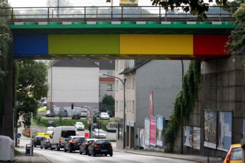Giant Lego Bridge in Germany by http://www.megx.de/?p=1059 In October of last year street artist Megx converted a bridge in Wuppertal, Germany into a giant Lego structure using colored panels that create the illusion of being the underside of Lego bricks. The bridge itself is part of the Wuppertal Bewegung e.V., an old train line that has been converted to a pedestrian and cycle path. See much more on his website. Photos above courtesy Lukas Power and Rolf Dellenbusch. (via kastormag)