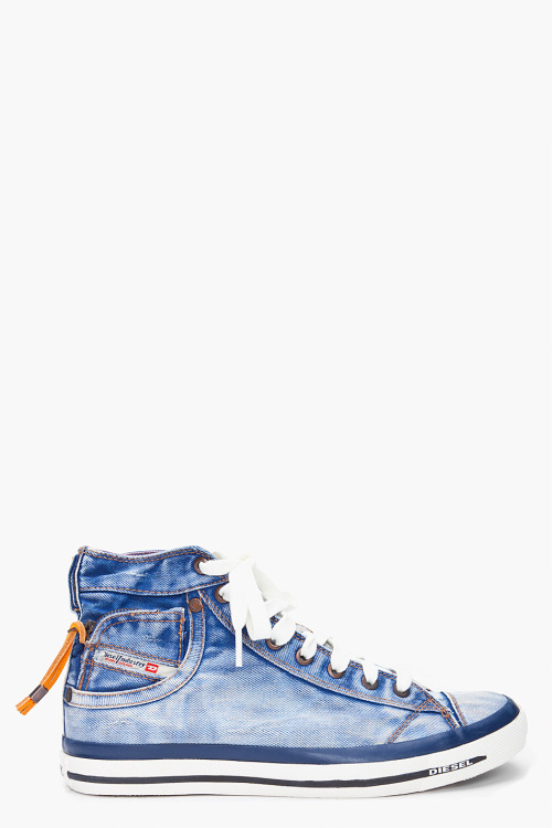 High Denim Expoiak Sneakers by DieselHigh-top distressed denim sneakers in blue. Fading and bronze markings throughout. Cap toe. White lace-up closure. Copper tone eyelets and logo rivets. Bronzed overlock stitching and blue logo stitching at tongue. Zip coin pocket with logo flag at outer side. Double loop at zip. Rubber midsole with textured foxing and black logo detail. Rubber sole. Bronze tone stitching throughout.  Upper: 100% textile. Sole: 100% rubber.