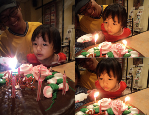 My niece so amazed by the candle's light on her dad's birthday cake. #Cute