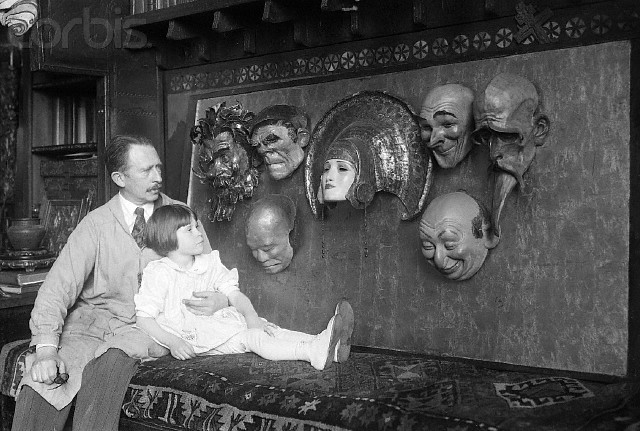 rrosehobart:  W.T. Benda with Daughter in Lap Looking at Masks : corbisimages.com