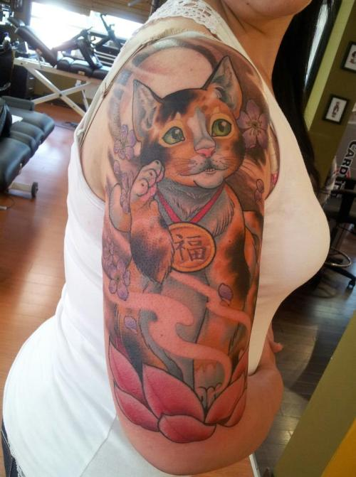 My Maneki Neko, done by Erin Lucas - Who was tattooing out of Bushido, Calgary. I sat from 11am to 6:45pm. Erin is based out of New Zealand but goes on the road often, she's one of my favorite artists so I was willing to sit for as long as it took.  I couldn't be more pleased with it, she's amazing!