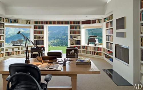 a summer house in mountain with a home office filled with books: spectacular!
