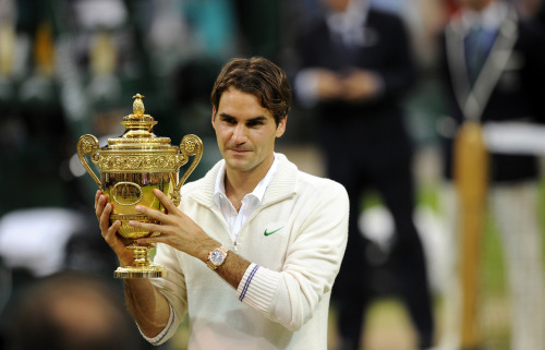 Ladies and gentlemen your Wimbledon Men's Champion 2012…. Mr Roger Federer