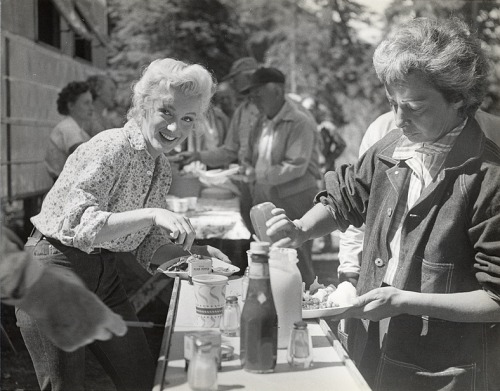 Marilyn Monroe tucks into lunch on the set of River of No Return